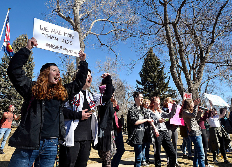 Berthoud High School students Madi Laib, far left, and Hunter James, left,   march to support mental health in schools with about fifty classmates Tuesday, March 7, 2018, in Berthoud. (Photo by Jenny Sparks/Loveland Reporter-Herald)