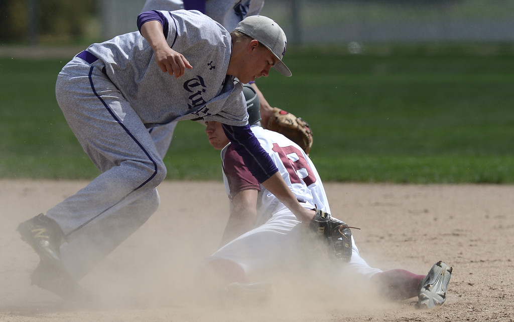. Berthoud�s, Aaron Hardy, 18, safely steals second base, beating a tag attempt by Holy Family second baseman, Josh Baker, at Berthoud High School where the Spartans took on Holy Family High School, Saturday April 27, 2019.