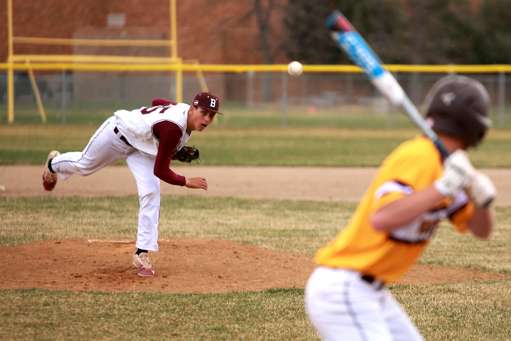 . Adrian Short (25) pitches the ball during Berthoud�s match against Windsor on April 6, 2018 in Berthoud, Colo. where Windsor beat Berthoud 7-0 