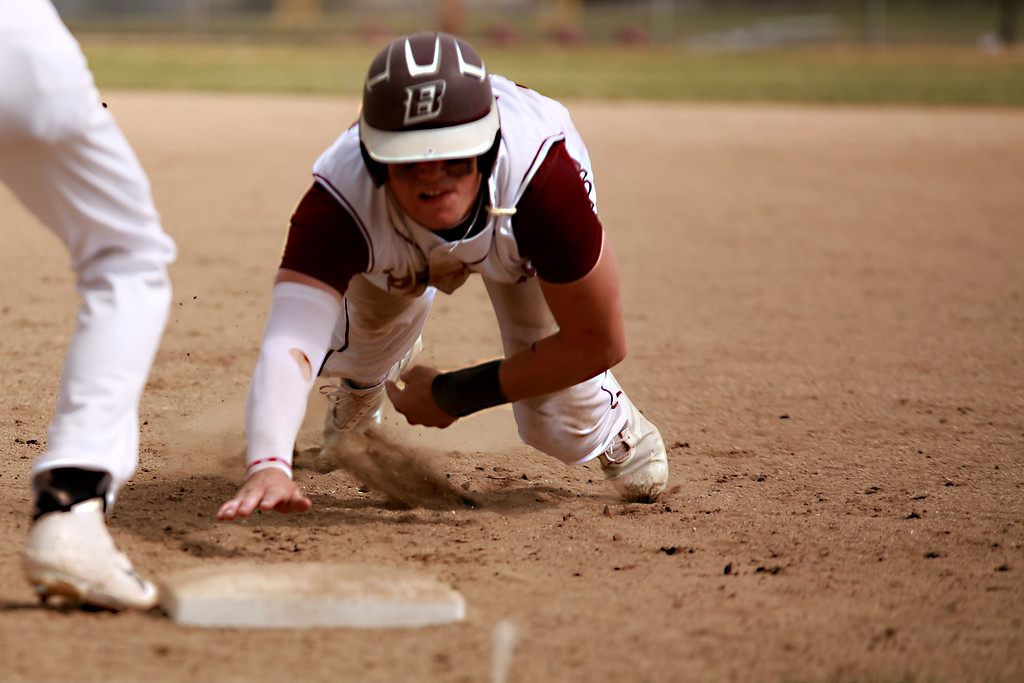 . Berthoud�s Jake Lozinski (38) dives into first base during their match against Windsor on April 6, 2019 in Berthoud Colo. where Windsor beat Berthoud 7-0.