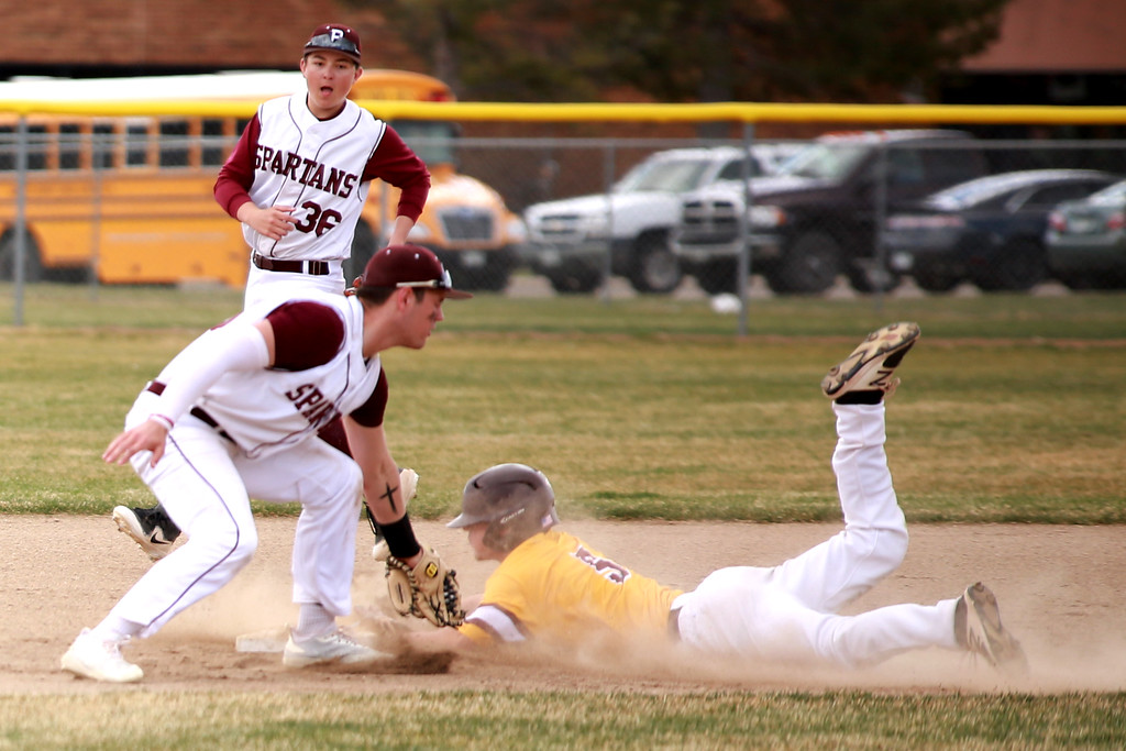 . Berthoud�s Jake Lozinski (38) and (36) Robert Ross face off against Windsor on April 6, 2019 in Berthoud Colo. where Windsor beat Berthoud 7-0.