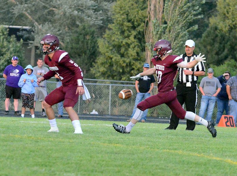 Berthoud's Brennen Garvin punts in the first quarter of Friday's game with Platte Valley at Marr Field. (Mike Brohard/Loveland Reporter-Herald)