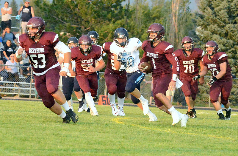 Berthoud quarterback Jake Lozinski follows his blockers as he breaks out of the pocket Friday night at Marr Field against Platte Valley. (Mike Brohard/Loveland Reporter-Herald)