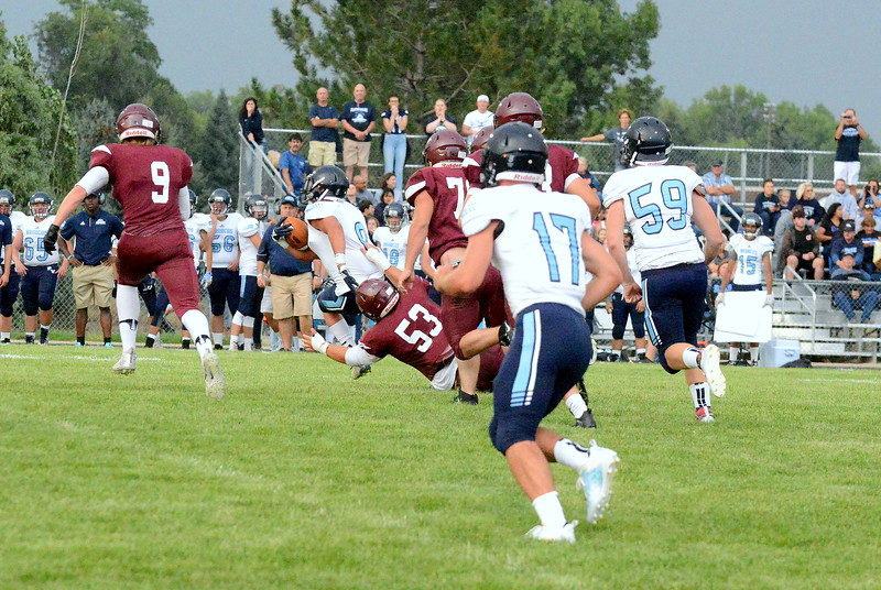 Berthoud's Ty Beaman drags down Platte Valley back Ernesto Rios during Friday's game at Marr Field. (Mike Brohard/Loveland Reporter-Herald)