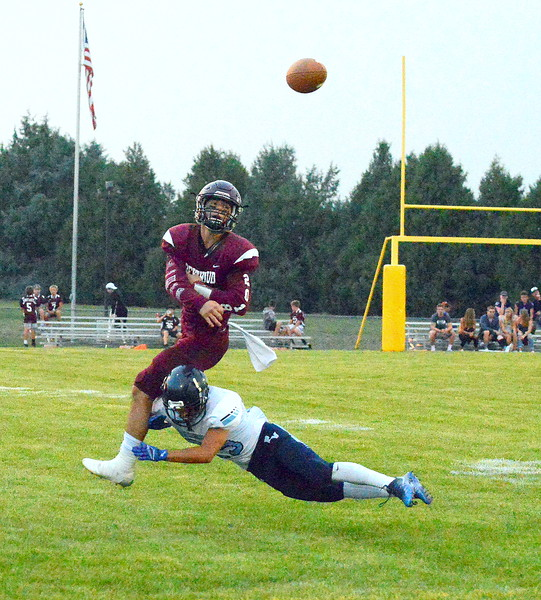 Berthoud quarterback Jake Lozinksi throws the ball away as he's pressured by Platte Valley's Alberto Perez in Friday's game at Marr Field. (Mike Brohard/Loveland Reporter-Herald)