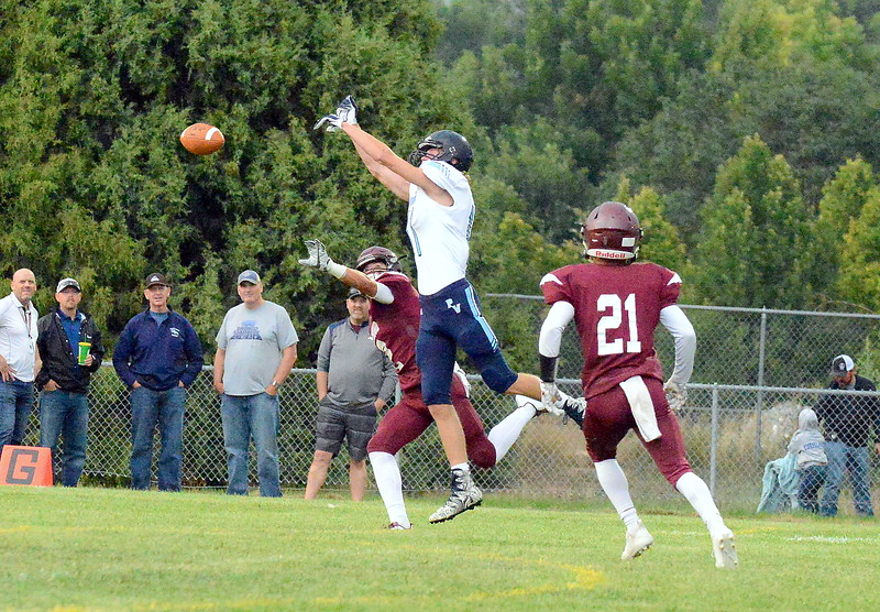 Berthoud's Danny Pehlphrey (2) defends as Platte Valley's Brendan Bunting can't come down with a pass in Friday's game at Marr Field. (Mike Brohard/Loveland Reporter-Herald)