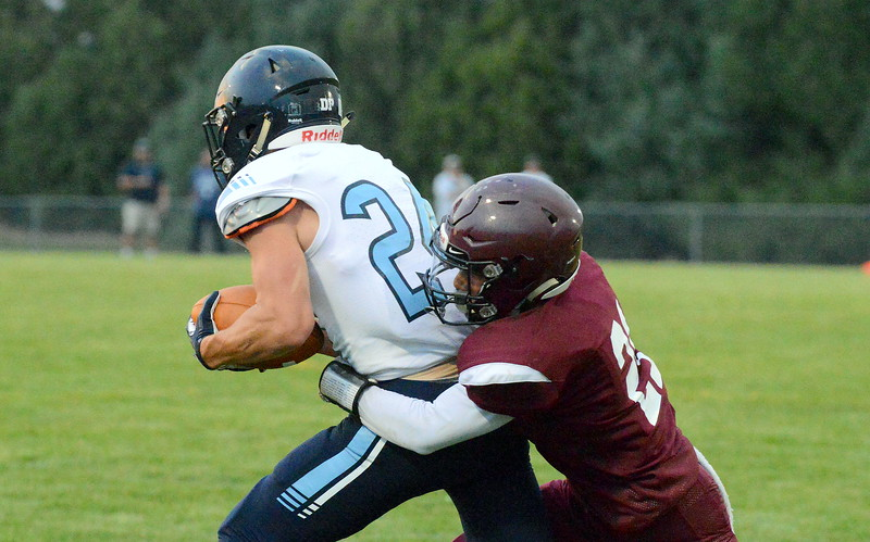 Berthoud's Miguel Sarmiento brings down Platte Valley's Josh Yancey for a short pass play during Friday's game at Marr Field. (Mike Brohard/Loveland Reporter-Herald)
