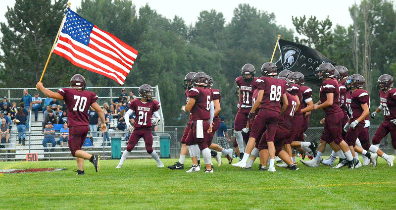 Berthoud's football team runs onto the field for Friday's season-opening game with No. 4 Platte Valley at Marr Field. (Mike Brohard/Loveland Reporter-Herald)
