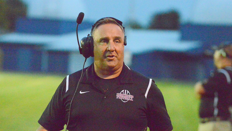 Berthoud coach Troy Diffendaffer walks the sidelines looking for offense in Friday's game with Platte Valley at Marr Field. (Mike Brohard/Loveland Reporter-Herald)