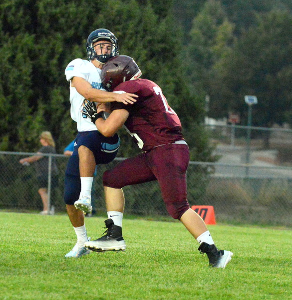 Berthoud's Caleb Kelly hits Platte Valley quarterback Trevon Wehrman as he throws a pass in Friday's game at Marr Field. (Mike Brohard/Loveland Reporter-Herald)