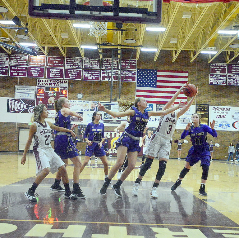 Berthoud's Emily Cavey goes for a rebound between Holy Family's Noelle Gardon (22) and Genavieve Gudino (11) during Friday's game Tri-Valley Conference game at the BHS gym. The Tigers beat the Spartans 52-50.
