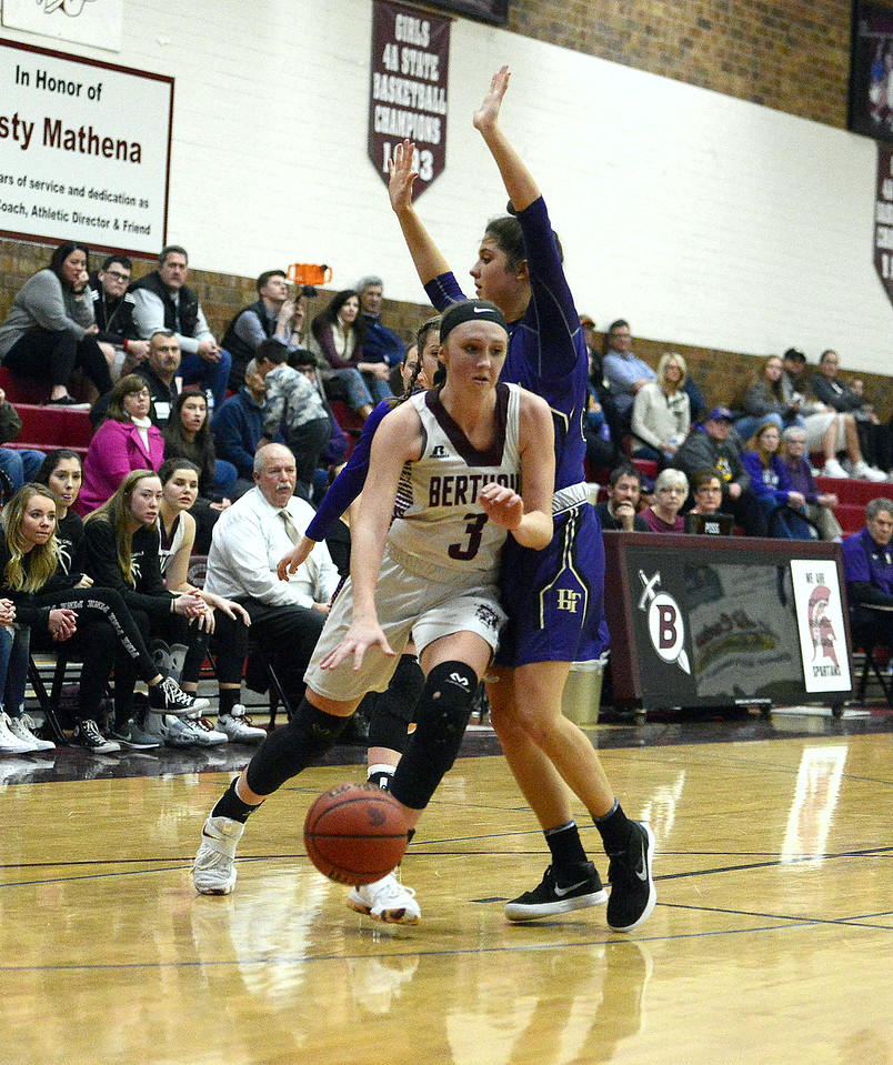Berthoud's Emily Cavey drives to the basket past Holy Family