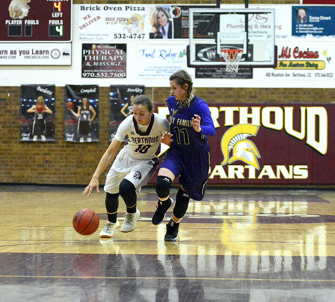 Berthoud guard Sydney Meis drives the lane as Holy Family's Genavieve Gudino defends during Friday's game Tri-Valley Conference game at the BHS gym. The Tigers beat the Spartans 52-50.
