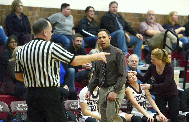 Berthoud coach Alan  Gibson talks to the referee about a call during Friday's game Tri-Valley Conference game at the BHS gym. The Tigers beat the Spartans 52-50.