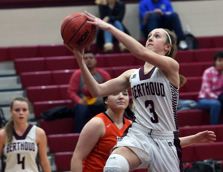 Berthoud's #3 Emily Cavey goes up for a shot during their game against Erie High School Tuesday, Jan. 3, 2017, at Berthoud High School. (Photo by Jenny Sparks/Loveland Reporter-Herald)