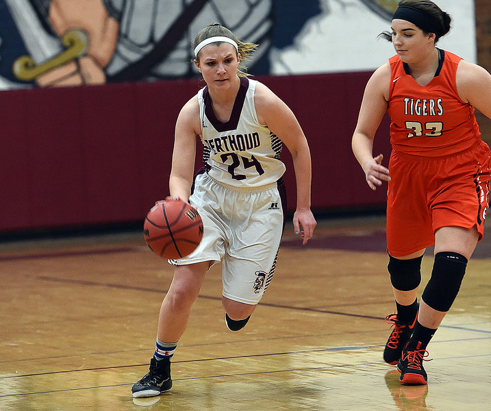 Berthoud's #24 Morgan Schachterle takes the ball down court during their game against Erie High School Tuesday, Jan. 3, 2017, at Berthoud High School. (Photo by Jenny Sparks/Loveland Reporter-Herald)