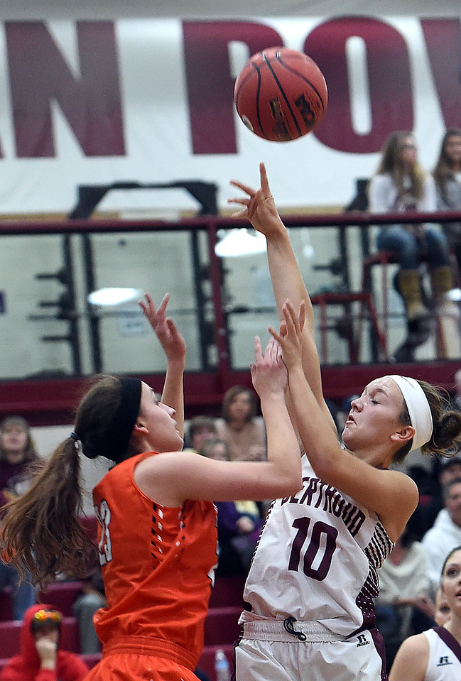 Berthoud's #10 Sydney Meis goes up for a shot as Erie's #23 tries to block during their game Tuesday, Jan. 3, 2017, at Berthoud High School. (Photo by Jenny Sparks/Loveland Reporter-Herald)