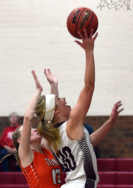 Berthoud's #30 Ashlee Burdette goes up for a shot as Erie's #17  tries to block during their game Tuesday, Jan. 3, 2017, at Berthoud High School. (Photo by Jenny Sparks/Loveland Reporter-Herald)