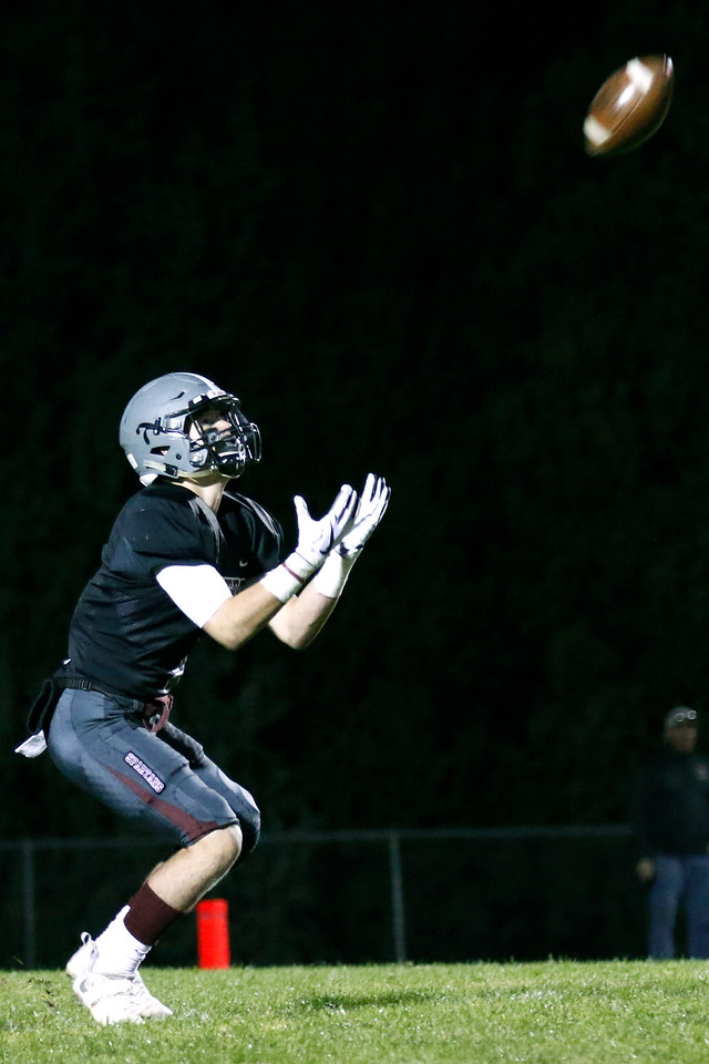 Berthoud's Jacob Lozinski (1) puts his hand out to catch a punt during the first quarter on Friday, Oct. 6, 2017, at Berthoud High School. (Photo by Lauren Cordova/Loveland Reporter-Herland)