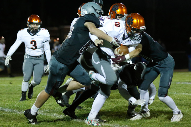 Berthoud's Levi Decker (85) and Wyatt Woodrick (15) try tackling Erie's Jacob Mansdorfer (10) on Friday, Oct. 6, 2017, at Berthoud High School. (Photo by Lauren Cordova/Loveland Reporter-Herland)