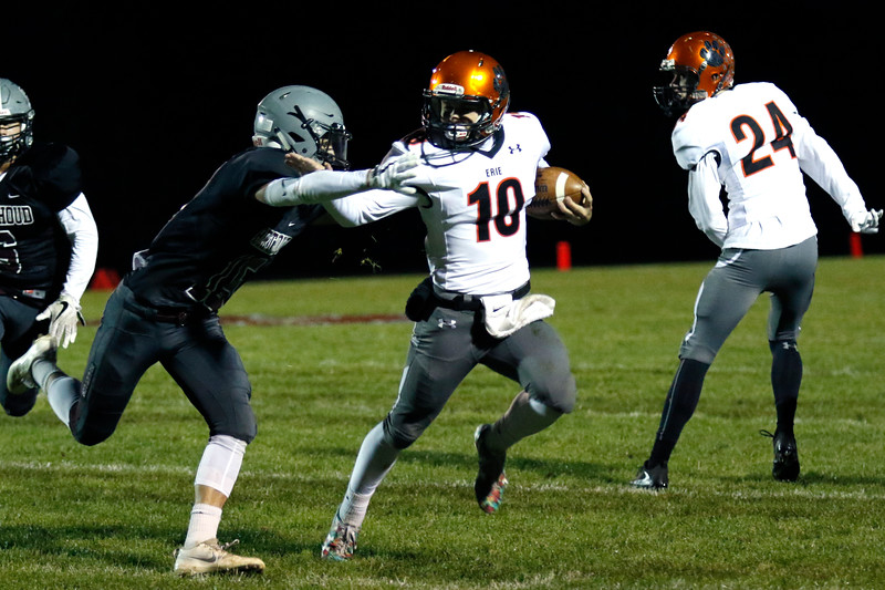 Erie's Jacob Mansdorfer (10) pushes off Berthoud's Wyatt Woodright (15) on Friday, Oct. 6, 2017, at Berthoud High School. (Photo by Lauren Cordova/Loveland Reporter-Herland)