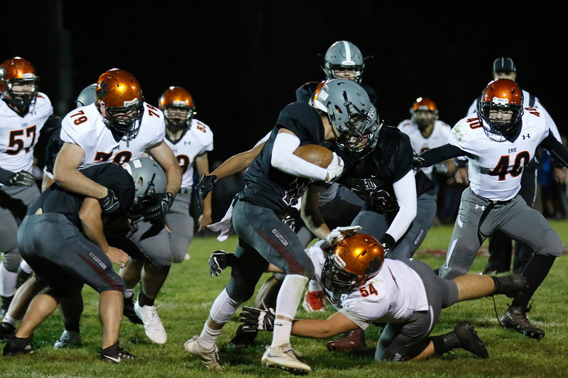 Erie's Nathan Hackney (54) jumps to tackle Berthoud's Wyatt Woodrick (15) while his teammates defend him on Friday, Oct. 6, 2017, at Berthoud High School. (Photo by Lauren Cordova/Loveland Reporter-Herland)