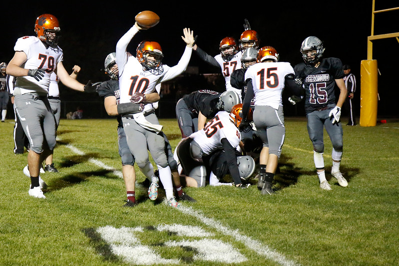 Erie's Jacob Mansdorfer (10) throws his hands up after he scores a touchdown while Berthoud's Dakota Rodriguez (50) tries to tackle him on Friday, Oct. 6, 2017, at Berthoud High School. (Photo by Lauren Cordova/Loveland Reporter-Herland)