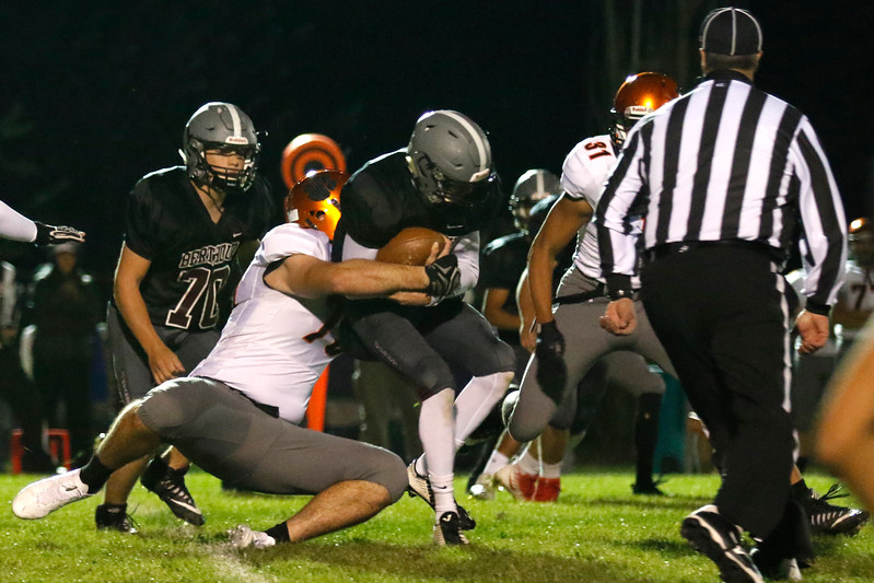 Erie's Cameron Marcucci (79) tackles Berthoud's Brock Voth (12) on Friday, Oct. 6, 2017, at Berthoud High School. (Photo by Lauren Cordova/Loveland Reporter-Herland)