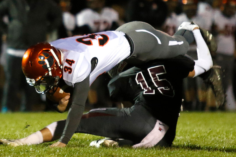 Berthoud's Wyatt Woodrick (15) tackles Erie's Colby Wingfield (34) in the first quarter on Friday, Oct. 6, 2017, at Berthoud High School. (Photo by Lauren Cordova/Loveland Reporter-Herland)