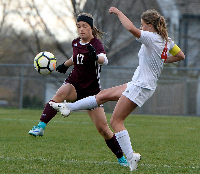Loveland's Riley Hall and Berthoud's Hailee Parsons battle for control of the ball during their game Thursday, May 1, 2019, at Berthoud High School.   (Photo by Jenny Sparks/Loveland Reporter-Herald)