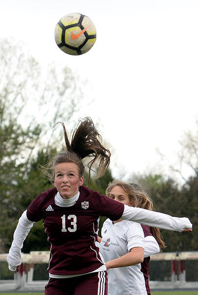 Berthoud's Hallie Cook hits a header during their game against Loveland Thursday, May 1, 2019, at Berthoud High School.   (Photo by Jenny Sparks/Loveland Reporter-Herald)