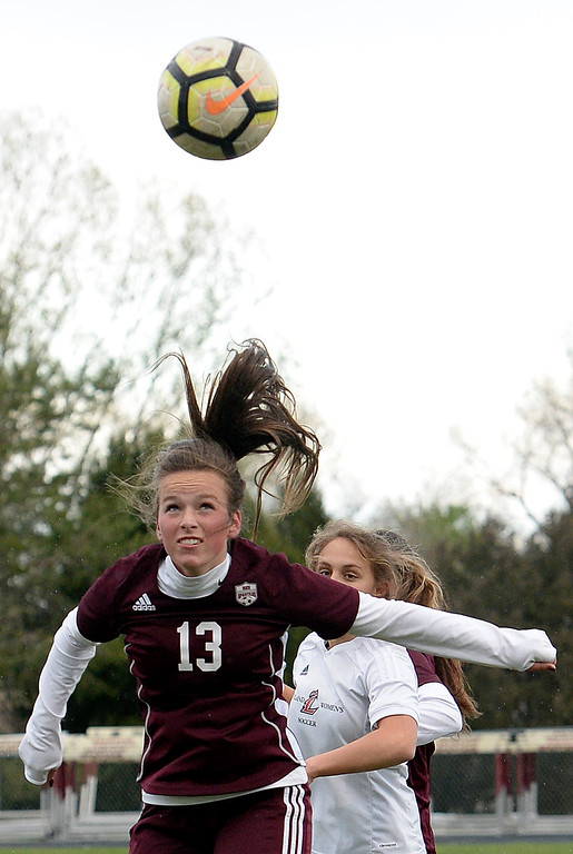 . Berthoud\'s Hallie Cook hits a header during their game against Loveland Thursday, May 1, 2019, at Berthoud High School.   (Photo by Jenny Sparks/Loveland Reporter-Herald)