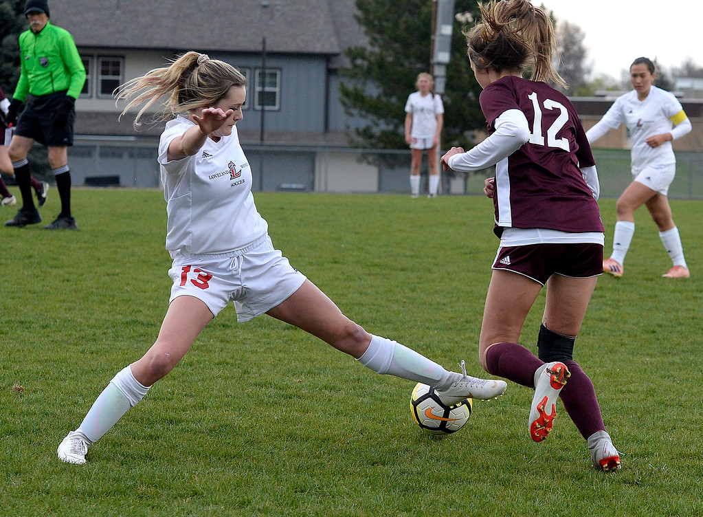 . Loveland\'s Aimee Lee tries to steal the ball from Berthoud\'s Maddie Barcewski during their game Thursday, May 1, 2019, at Berthoud High School.   (Photo by Jenny Sparks/Loveland Reporter-Herald)