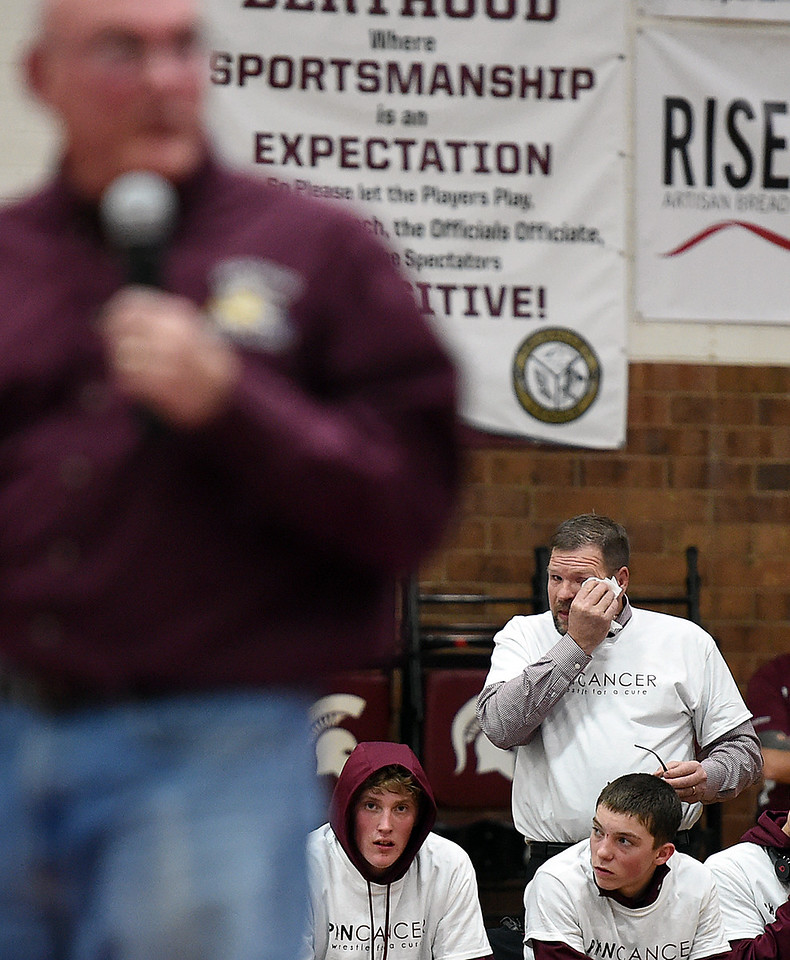 Berthoud High School wrestling coach Scott Pickert, right, igets emotional as Mike Shearer, his friend and former assistant wrestling coach, talks about him Thursday, Feb. 2, 2017, as the school takes a moment to thank Pickert for his years of service. (Photo by Jenny Sparks/Loveland Reporter-Herald)