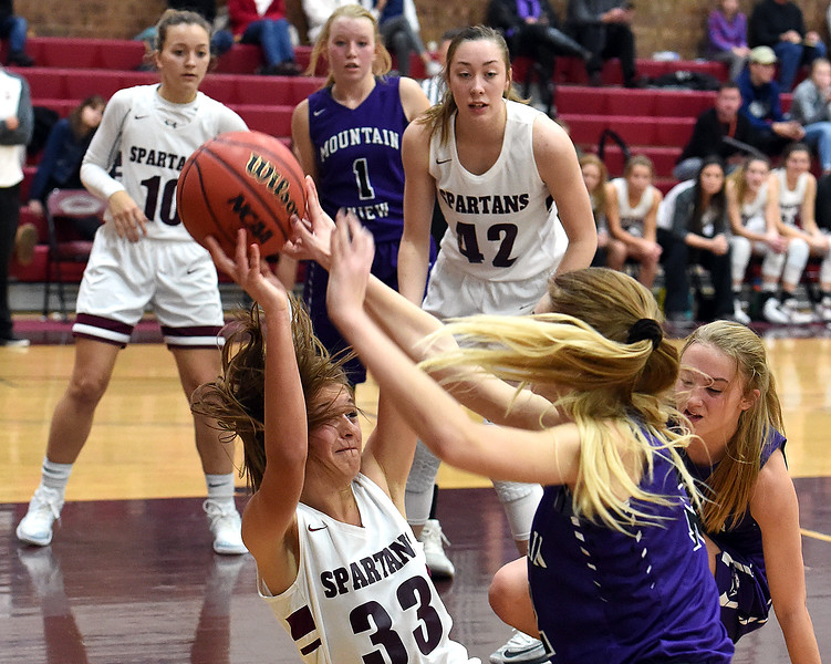 Berthoud's Maddie Barcewski and Mountain View's Chloe Miller fight for control of the ball during their game Thursday, Dec. 6, 2018, at Berthoud High School.  (Jenny Sparks/Loveland Reporter-Herald)