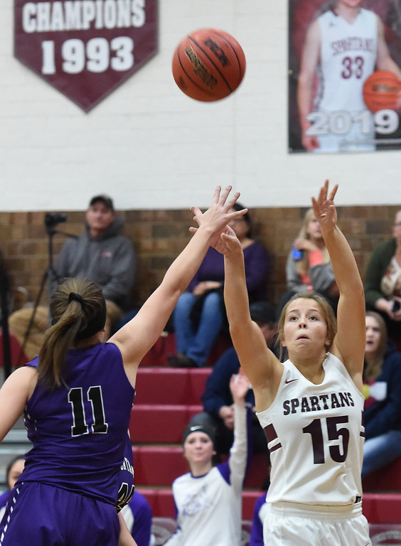 . Berthoud\'s Addi Spears goes up for a shot past Mountain View\'s  Kelsey Basart during their game Thursday, Dec. 6, 2018, at Berthoud High School.  (Jenny Sparks/Loveland Reporter-Herald)