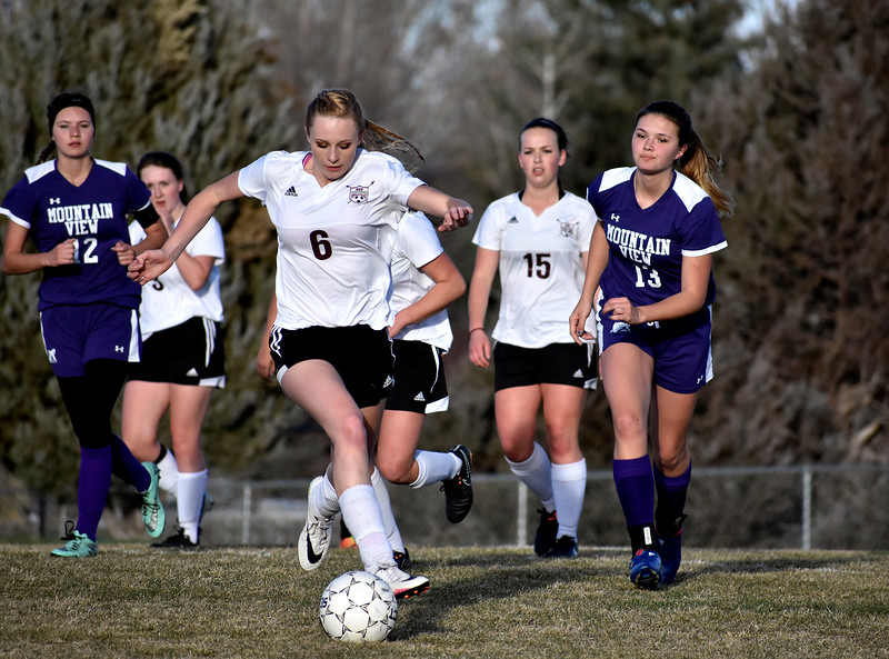 Berthoud's (6) Hailey Pepper manages to prevent Mountain View from scoring by blocking the ball during their game on Friday, March 23, 2018 at Berthoud High School in Berthoud. Photo by Thieng Mai/Loveland Reporter-Herald.
