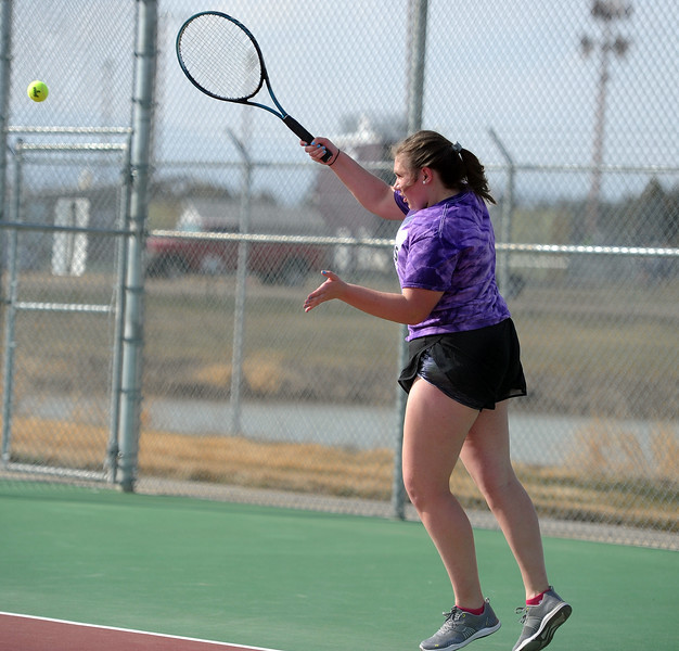 Natalie Alsum nails a forehand during her No. 3 singles match at BHS courts on Thursday, March 28. Berthoud won 7-0. (Colin Barnard/Loveland Reporter-Herald)