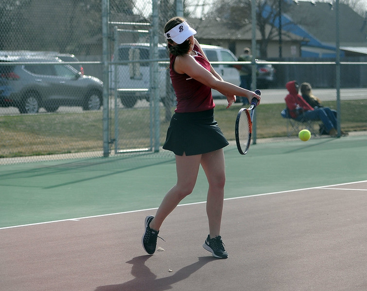 Ellie Yuska drills a forehand during the No. 3 doubles match at BHS courts on Thursday, March 28. Berthoud won 7-0. (Colin Barnard/Loveland Reporter-Herald)