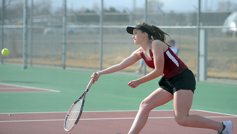 Emma Lundgreen lunges for a ball in her No. 3 singles match at BHS courts on Thursday, March 28. Berthoud won 7-0. (Colin Barnard/Loveland Reporter-Herald)