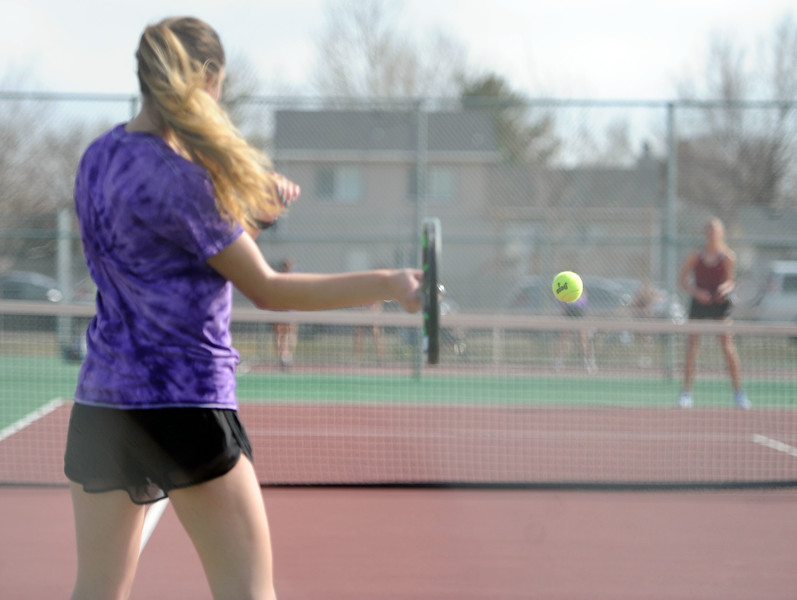 Kendall Krieger returns a shot against Berthoud at BHS courts on Thursday, March 28. Berthoud won 7-0. (Colin Barnard/Loveland Reporter-Herald)