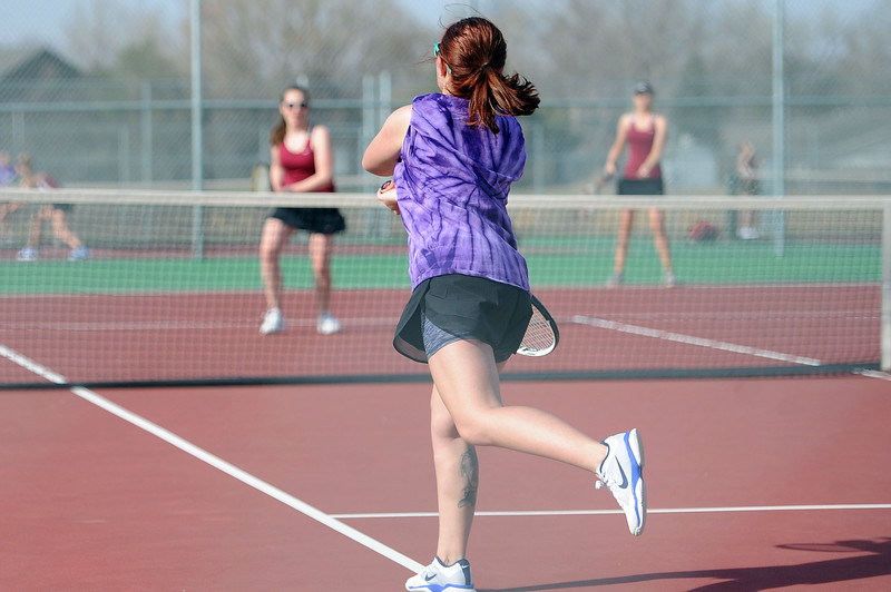 Valentina Vigil finishes a backhand during the No. 2 doubles match at BHS courts on Thursday, March 28. Berthoud won 7-0. (Colin Barnard/Loveland Reporter-Herald)