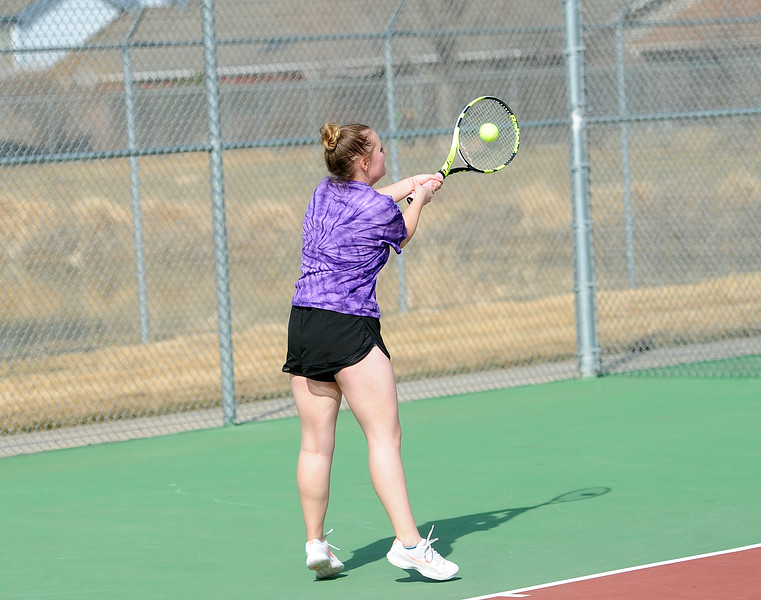 Audra Axline reaches for a backhand in her No. 1 singles match at BHS courts on Thursday, March 28. Berthoud won 7-0. (Colin Barnard/Loveland Reporter-Herald)