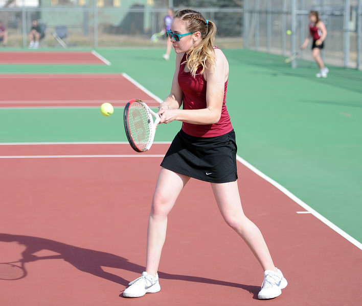 Delaney Lord winds up for a backhand during the No. 1 doubles match at BHS courts on Thursday, March 28. Berthoud won 7-0. (Colin Barnard/Loveland Reporter-Herald)