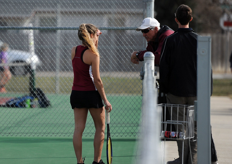 Eriana Rennaker chats with coaches during her No. 1 singles match at BHS courts on Thursday, March 28. Berthoud won 7-0. (Colin Barnard/Loveland Reporter-Herald)