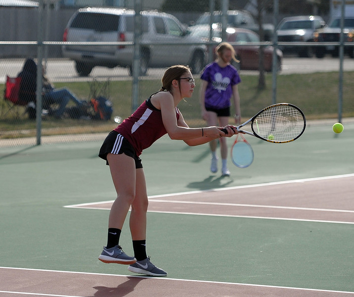 Sydney Hocker reaches for a backhand during the No. 3 doubles match at BHS courts on Thursday, March 28. Berthoud won 7-0. (Colin Barnard/Loveland Reporter-Herald)