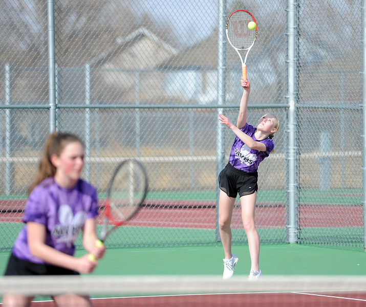 Mandy McNulty connects on a serve during the No. 1 doubles match at BHS courts on Thursday, March 28. Berthoud won 7-0. (Colin Barnard/Loveland Reporter-Herald)