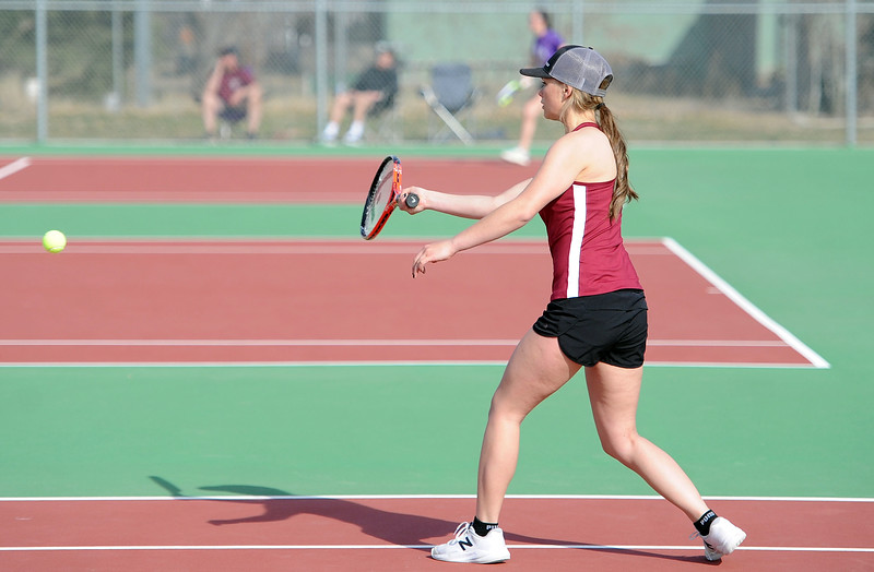 Kali Thoren hits a forehand in her No. 1 doubles match at BHS courts on Thursday, March 28. Berthoud won 7-0. (Colin Barnard/Loveland Reporter-Herald)