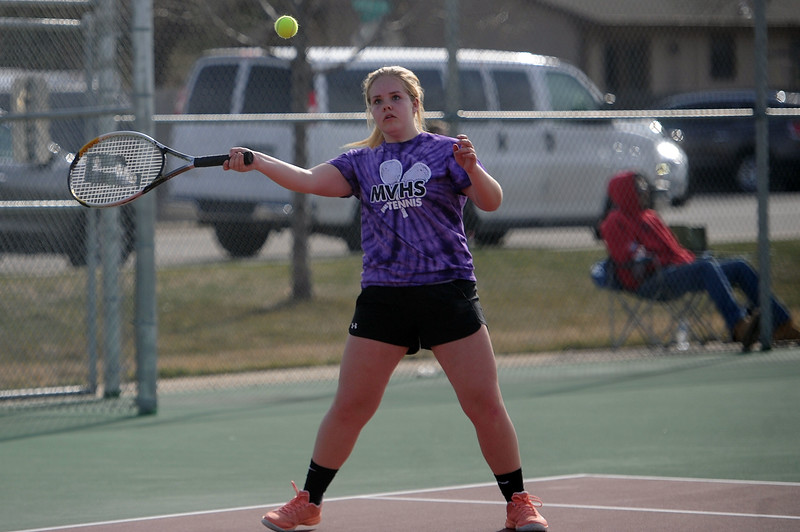 Kendall Millward eyes a forehand during the No. 3 doubles match at BHS courts on Thursday, March 28. Berthoud won 7-0. (Colin Barnard/Loveland Reporter-Herald)