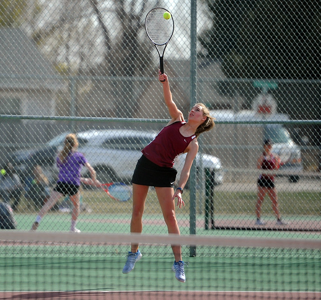 Gretchen Marty jumps for a serve during her No. 2 singles match at BHS courts on Thursday, March 28. Berthoud won 7-0. (Colin Barnard/Loveland Reporter-Herald)